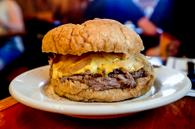Brennan & Carr. Burger topped with roast beef, gravy, Cheese Whiz, and onions