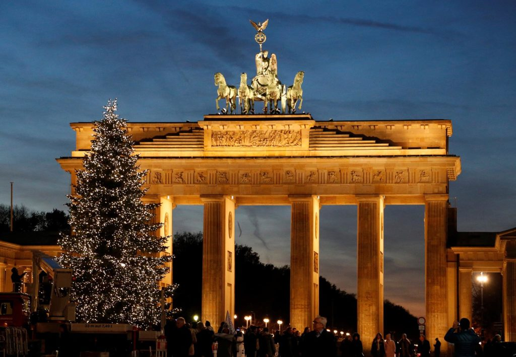 An illuminated Christmas tree is pictured in front of the Brandenburg Gate in Berlin, Germany November 24, 2016. REUTERS/Fabrizio Bensch