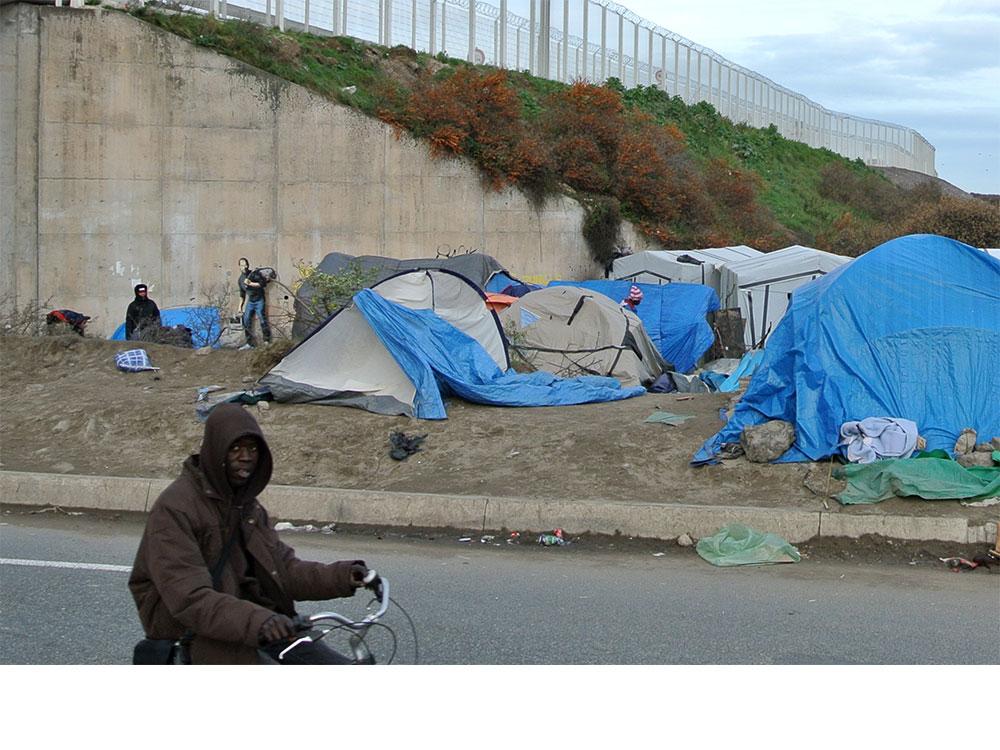 Banksy paints Steve Jobs on a wall in Calais