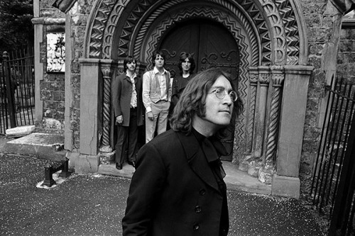 The Beatles in front of the entrance