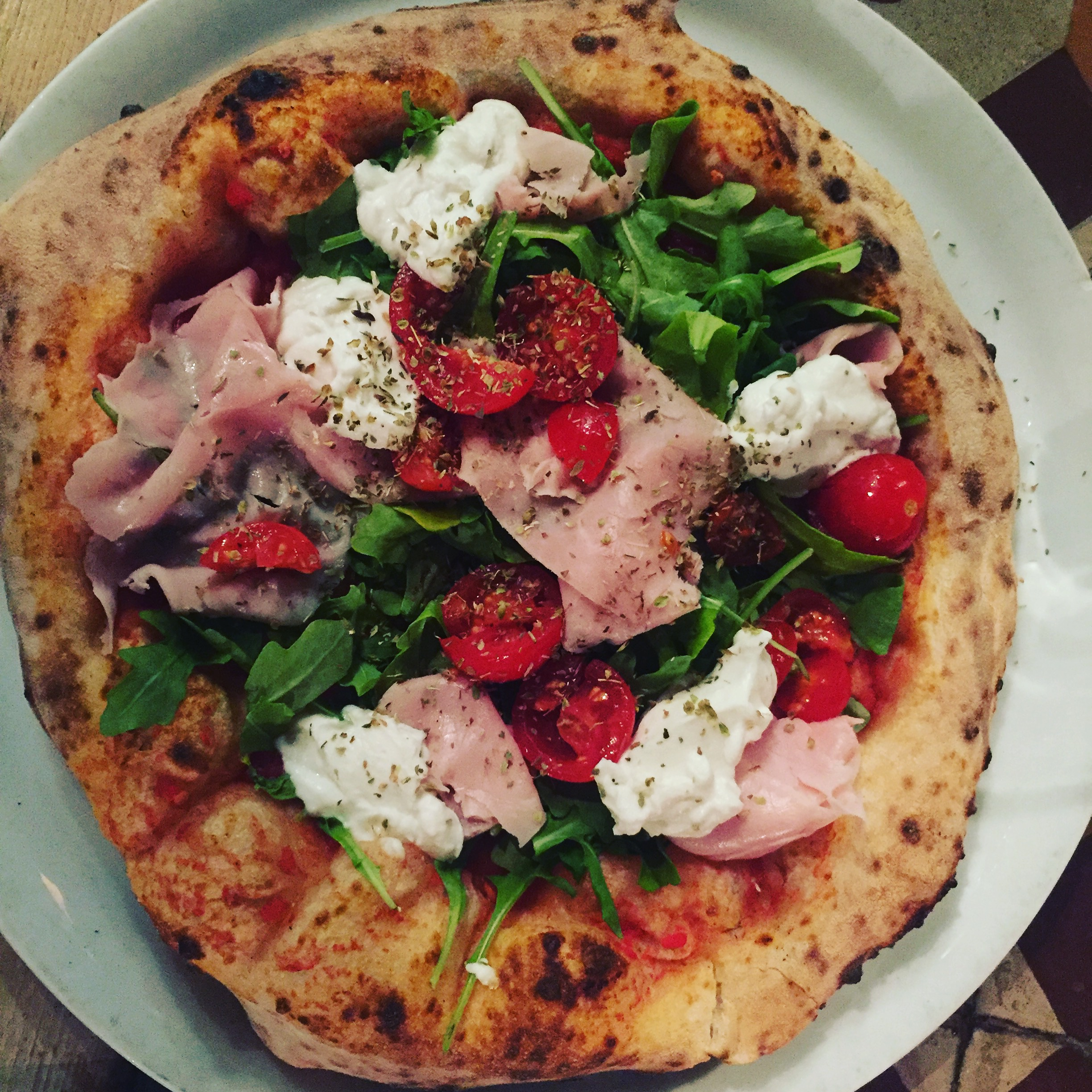 Rosso Pomodo's whole wheat. Buffalo ricotta, ham, rocket, cherry tomatoes and tomato sauce.