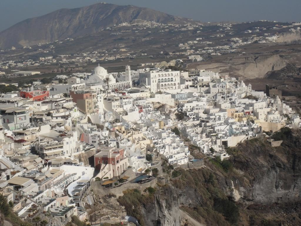 Fira at the top of the hill. Picture taken from Firostefani.