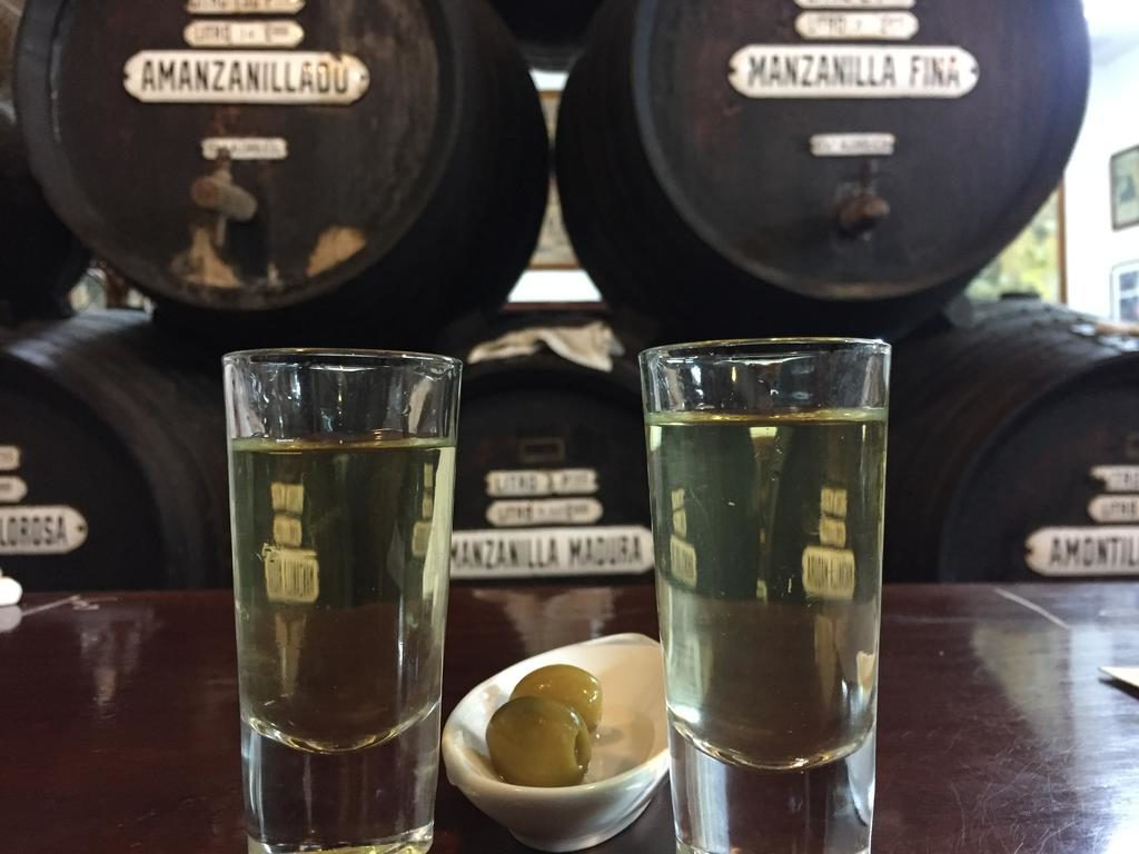 Taberna de la Manzanilla. Two glasses of Sherry and olives.